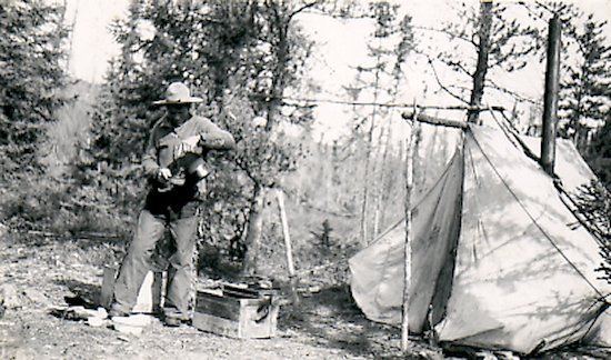 Fred pouring tea in camp