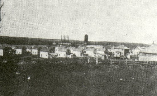 The 'Company Town' - 1916, with mill and burner in background.
