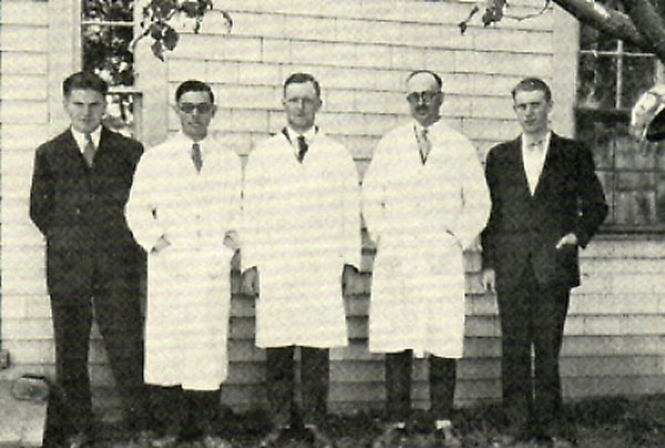 The only privately owned veterinary practice dealing with fur-bearing animals. It was in existence from the middle twenties to the middle thirties. The staff of Dr Cunningham's Laboratory, Summerside, P.E.I. left to right: Edward Arnett, A. H. Kennedy, A. A. Kingscote, J. R. Cunningham and Rendle Bowness.
