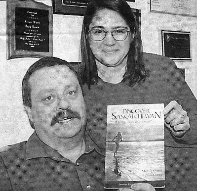 Michael and Anna Clancy with Discover Saskatchewan Book.