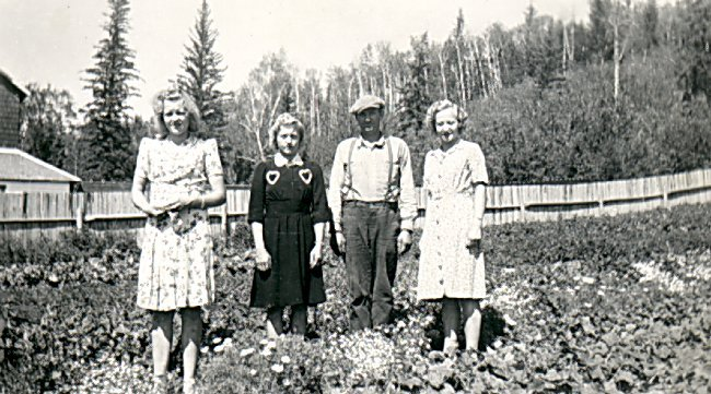 (L-R) Mary, Marjorie, Halvor and Ann Ausland, in the Garden at Deep River, circa 1943.