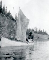 Ed Theriau in Canoe With Sail.