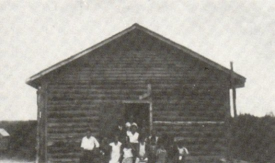 Delaronde School - also used as the church. H.S. Blezard and congregation - 1935.