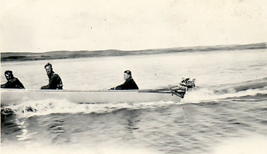 Fred Darbyshire and unidentified trappers in a canoe