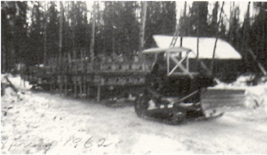Spring 1962. Ted Johnson hauling 3 sleigh loads of mink pens. <br> Moving from Murray's Point to South Bay.