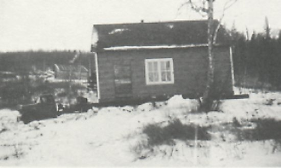 Moving Viden's house from Murry's Point. Snell's house in the background was also moved to South Bay.