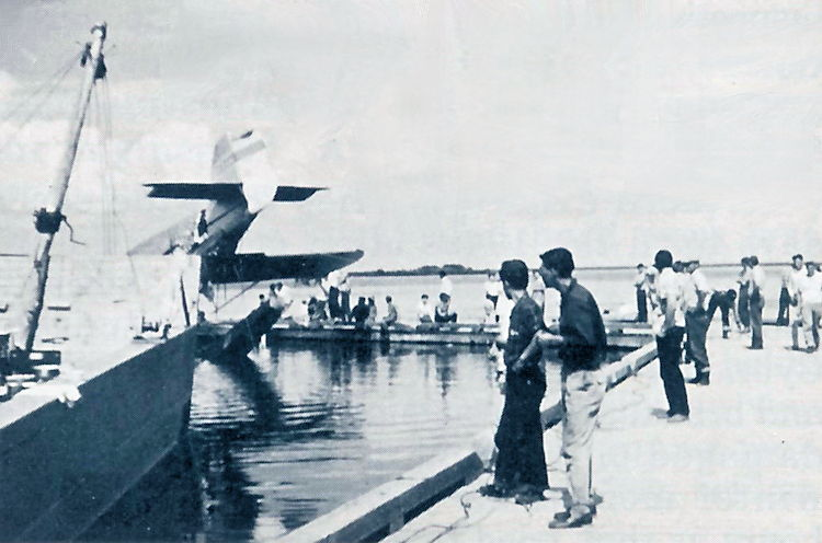 A crowd gathered on the dock at Ile-la-Crosse.